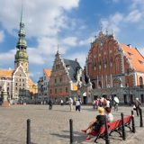 Latvia-Riga-Town-Hall-Square-with-House-of-he-Blackheads-and-Saint-Peters-Church-in-distance